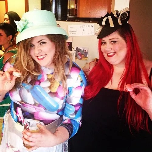 two fat women wearing awesome derby hats