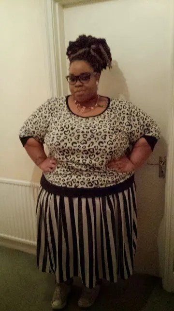 plus size monochrome outfit with black and white leopard top and black and white striped skirt