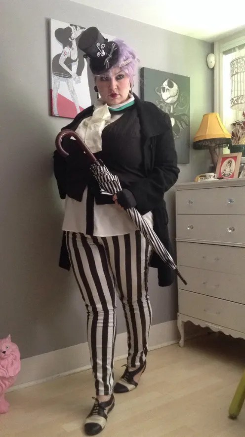plus size anna piaggi inspired out with black and white striped pants, tiny hat, white ruffle shirt and black jacket