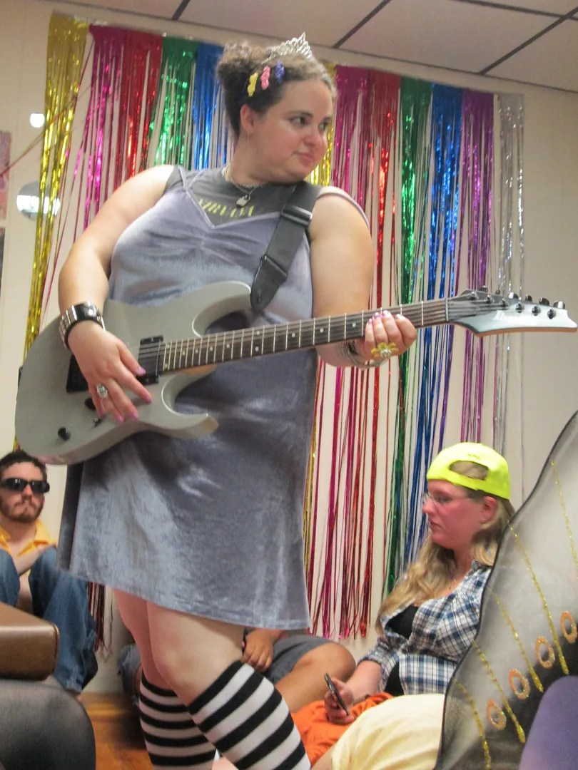 me playing guitar dressed in 90s outfit riot grrl