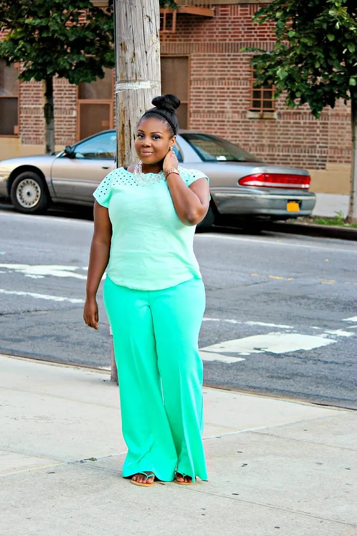 plus size outfit with light mint top and darker mint green pants
