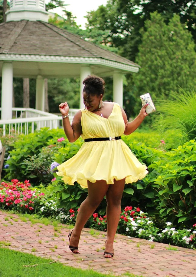 plus size outfit yellow dress twirling in front of gazebo