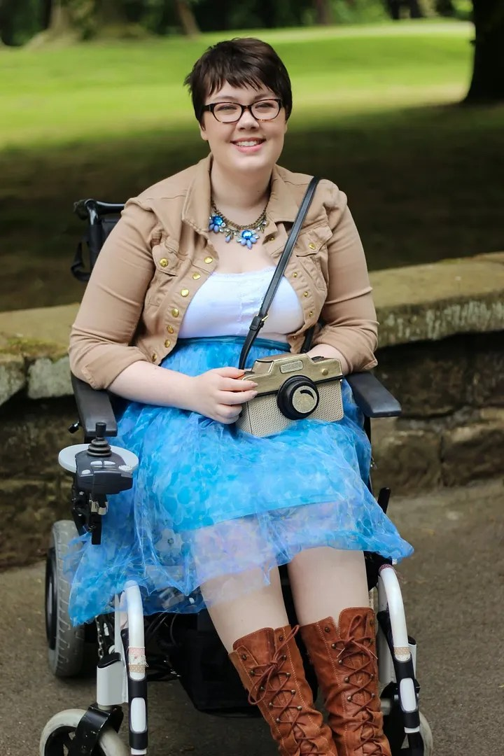 plus size blue and white outfit with brown jacket and boots wheelchair fashion