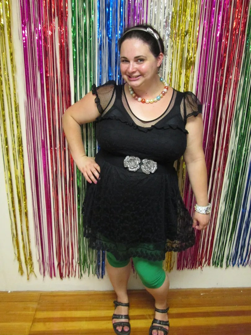 plus size outfit with black dress and green teggings