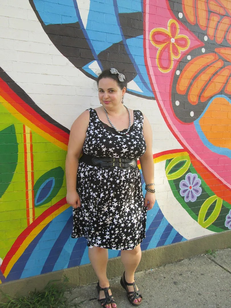 plus size outfit picture with colorful graffiti wall background
