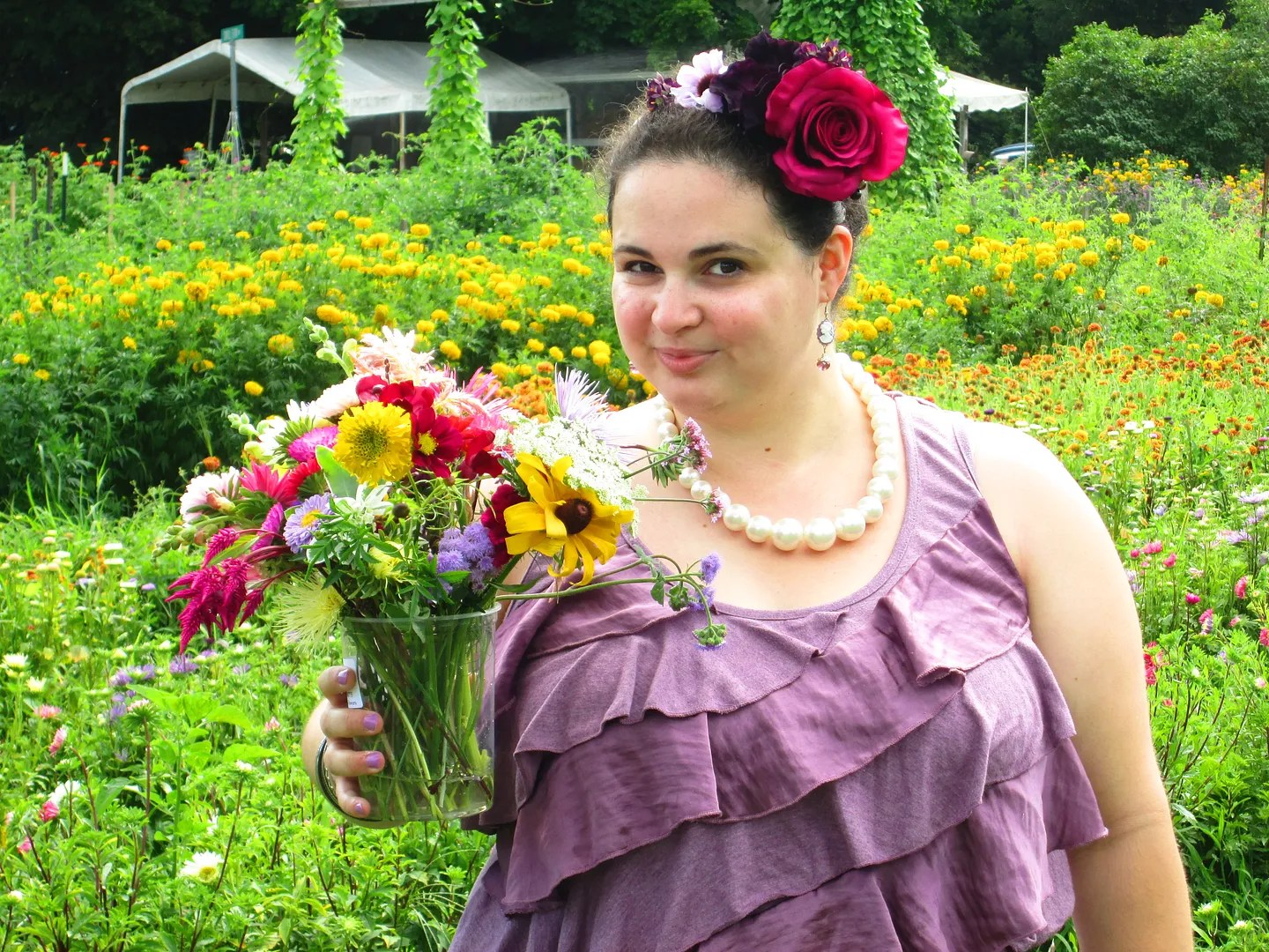 plus size purple outfit with flowers in field