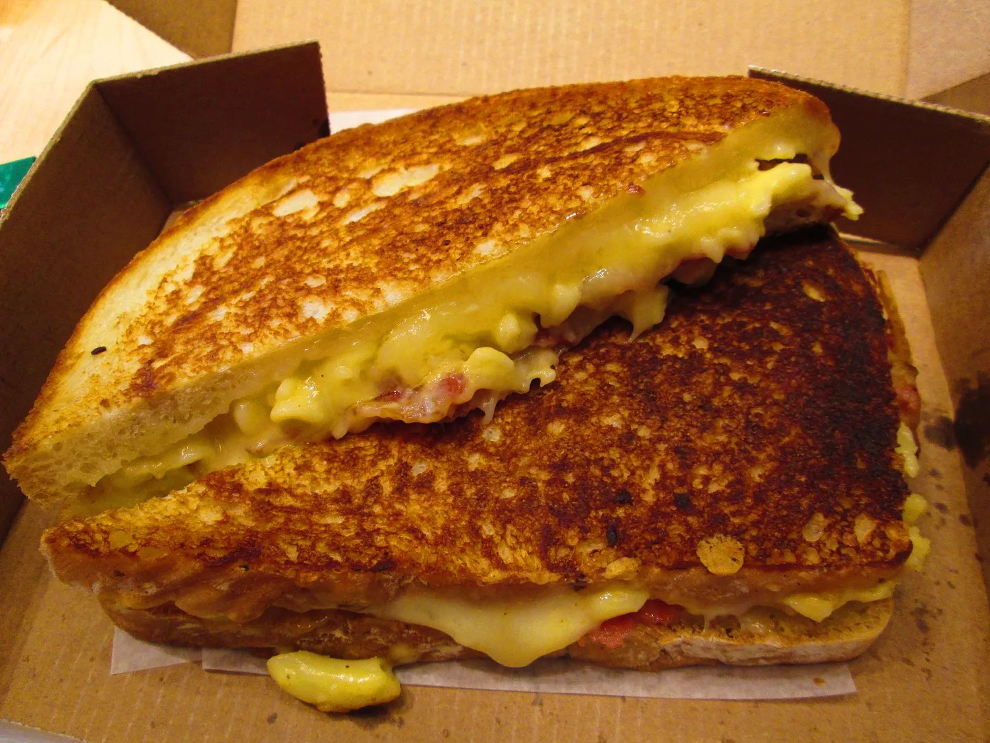 grilled cheese with bacon and macaroni and cheese inside