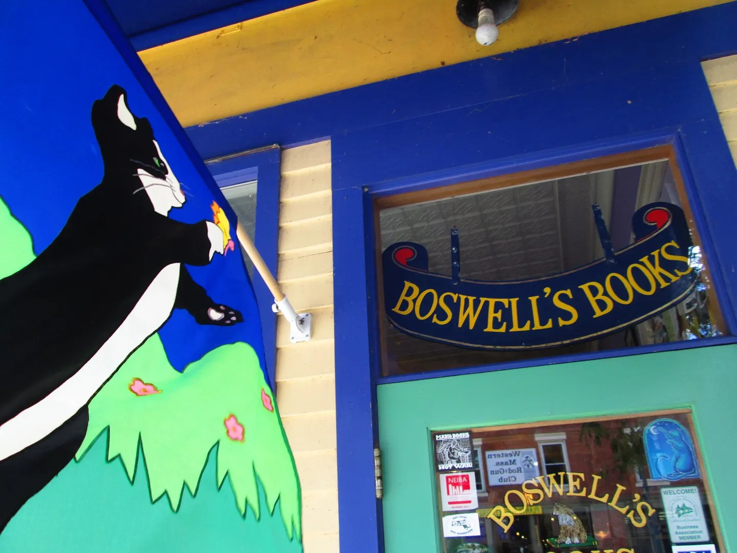 boswell's books front door and flag with picture of cat