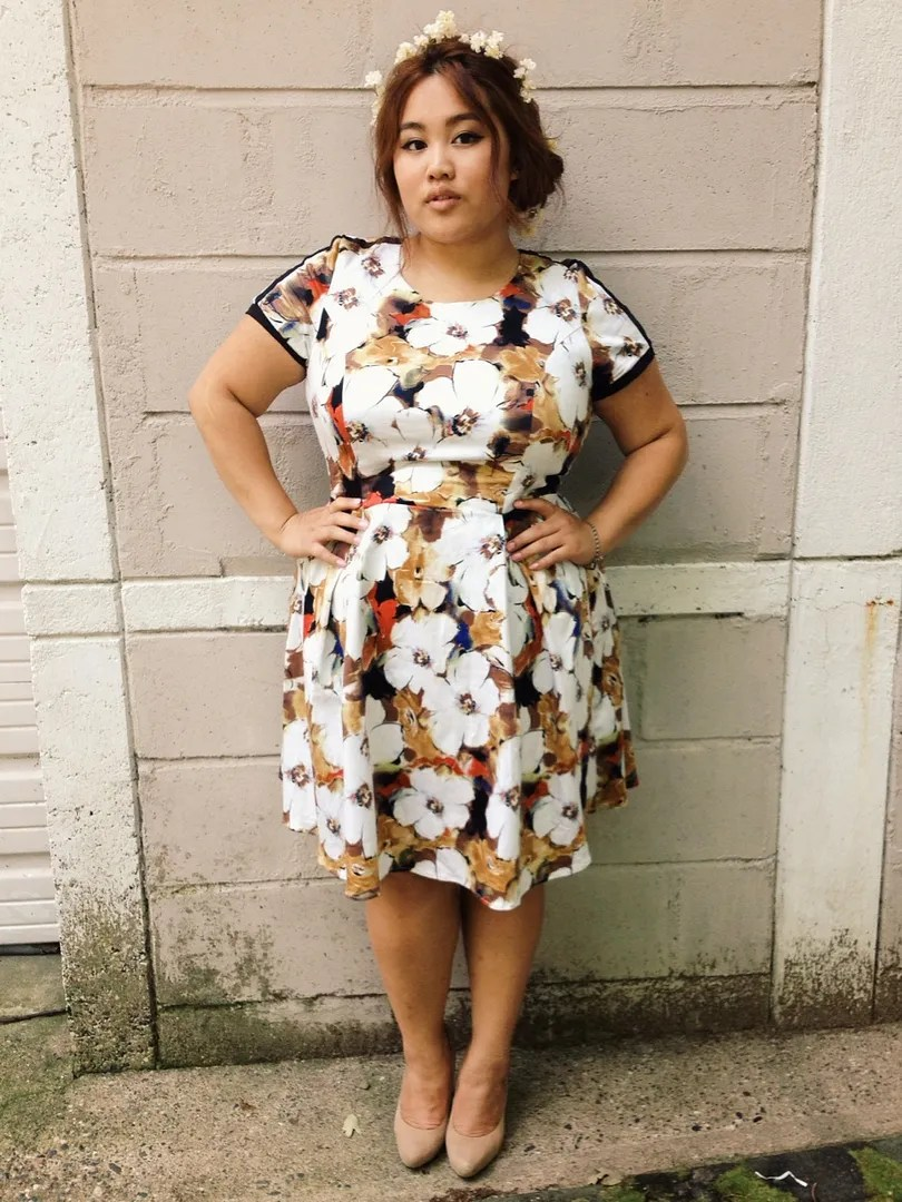 plus size brown, white, and orange floral dress with flower crown