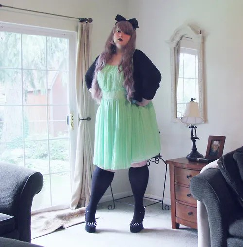 plus size mint green tulle dress with black knee socks, cardigan, and hair bow