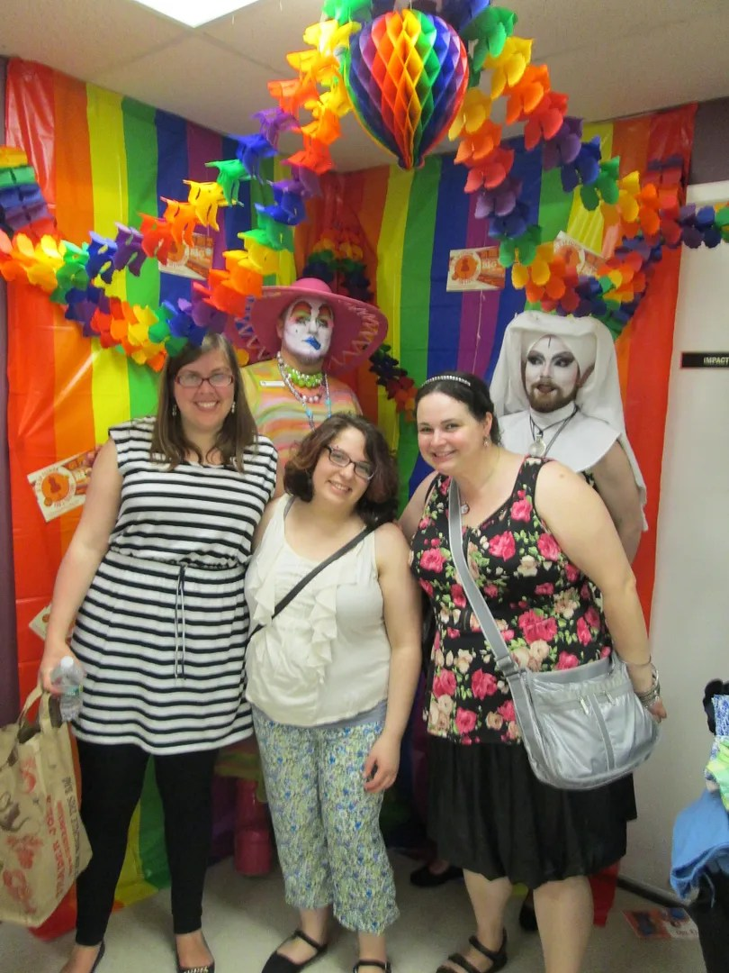three women and two drag nuns in rainbow photobooth