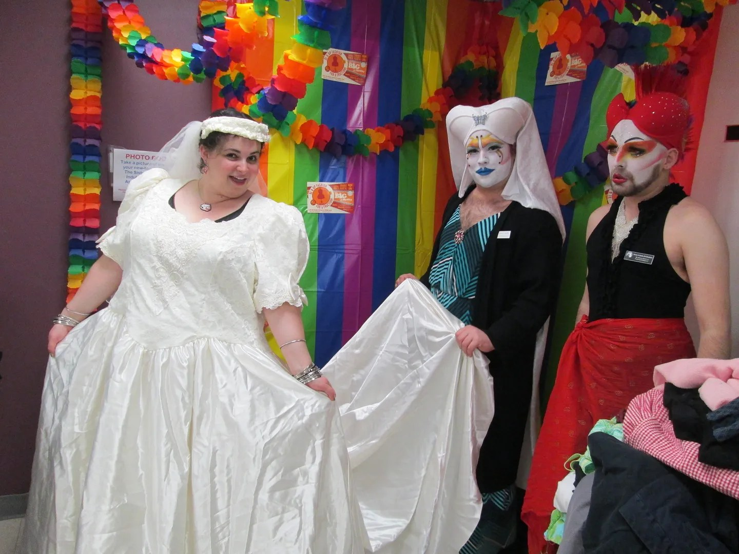 woman wearing 80s wedding dress with two queer nuns as bridesmaids