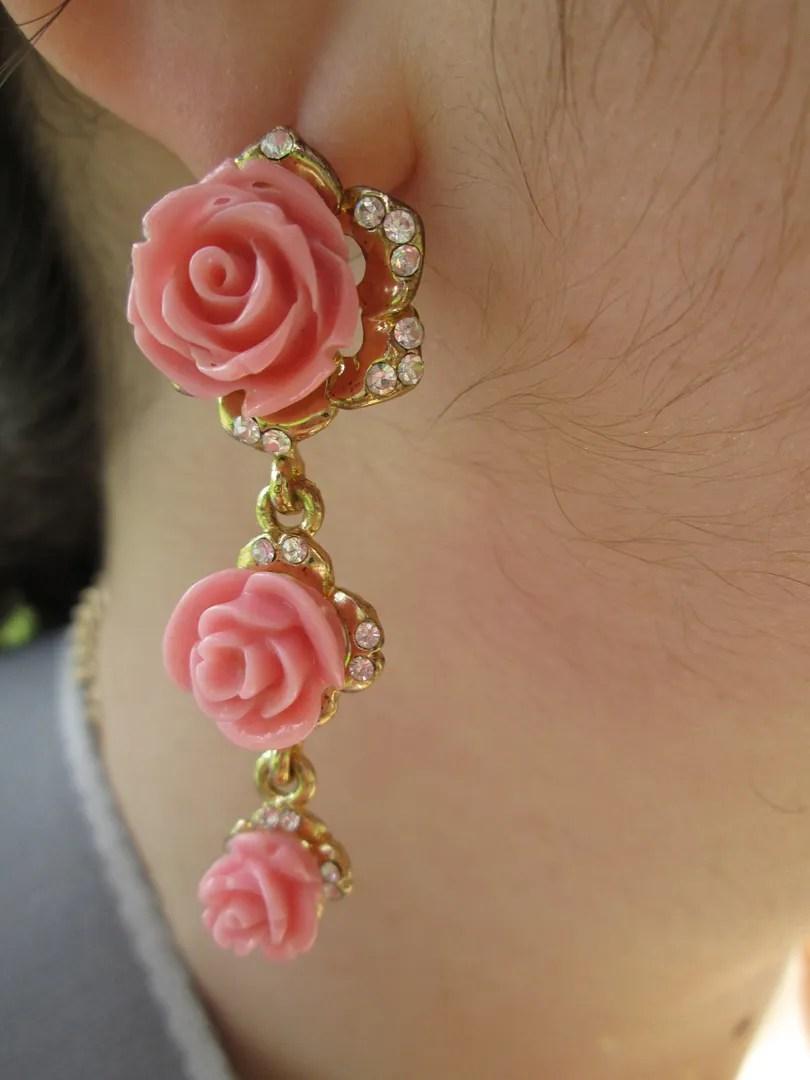 close-up of pink rose earrings