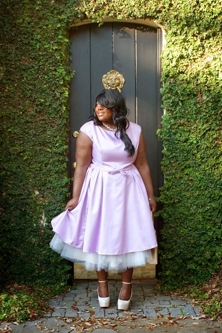 woman wearing glamorous vintage lavender satin dress with white tutu