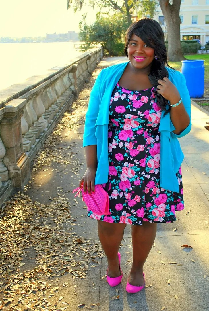 plus size outfit with black and pink floral dress, blue cardigan, and hot pink shoes