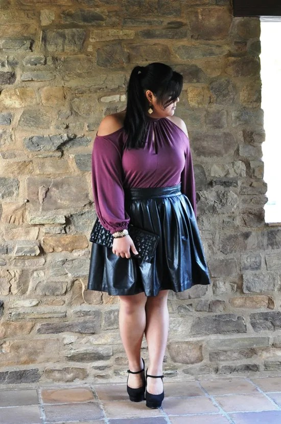 plus size outfit with purple top and black leather skirt