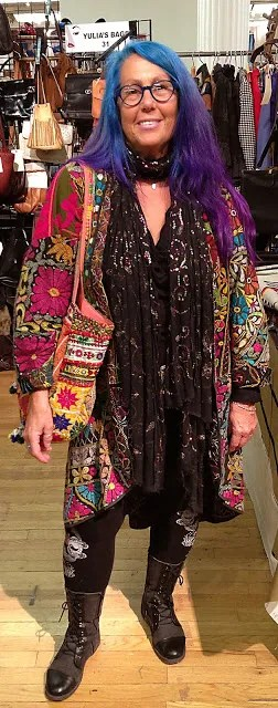 older woman with blue and purple ombre hair and bohemian flowing colorful clothes