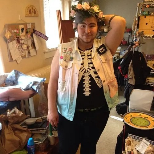 plus size outfit with dip-dyed denim vest, skeleton shirt, and floral crown
