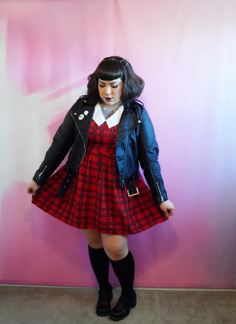 plus size punk 90s outfit with red plaid dress and leather jacket