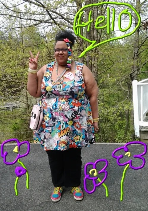 plus size woman wearing colorful cartoon dress, black pants, colorful sneakers, and baby barrettes