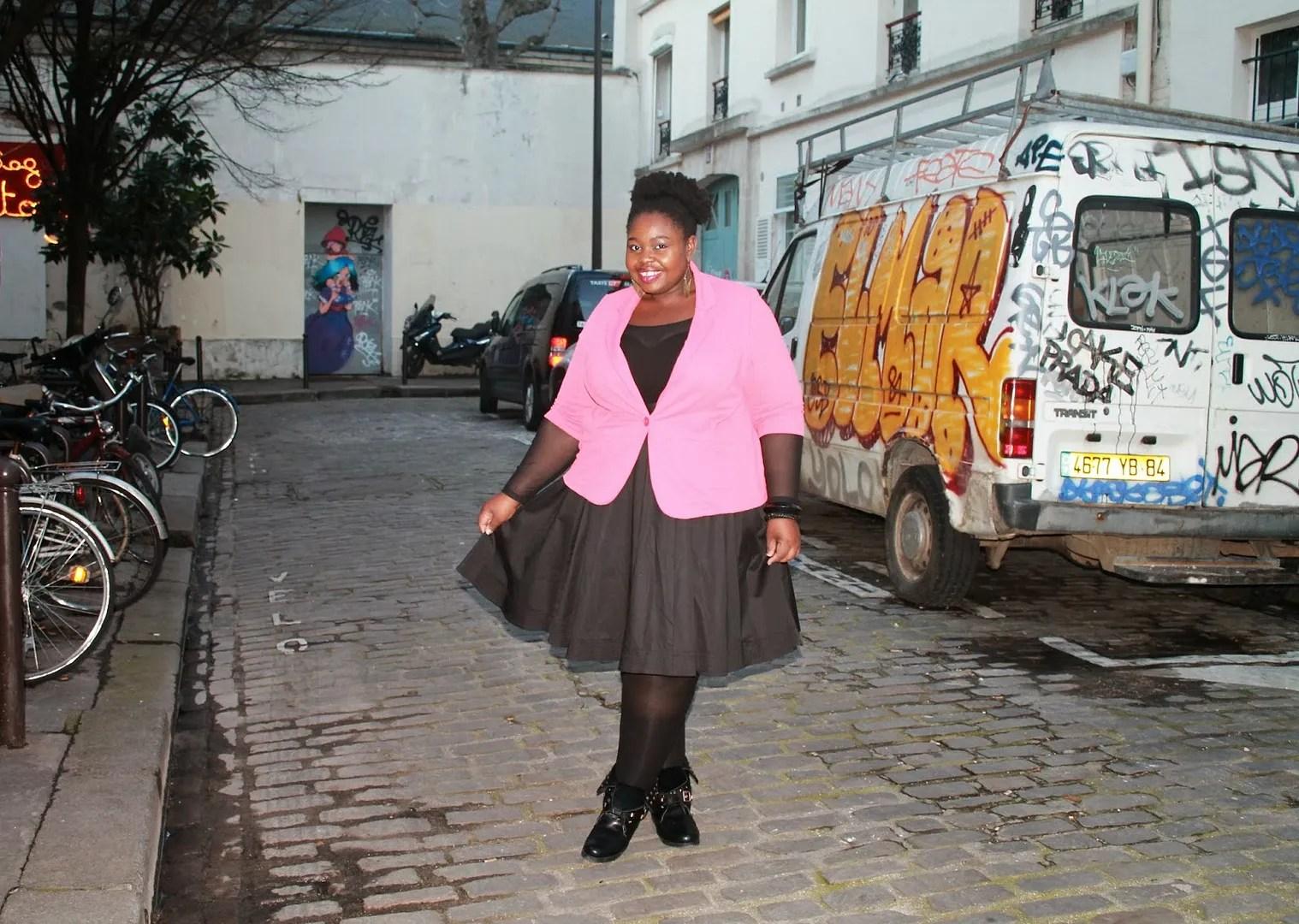 plus size woman wearing black dress and pink blazer