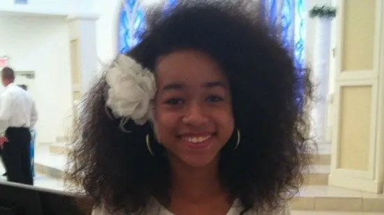 image of a thin, pretty, black teenage girl with shoulder-length natural hair