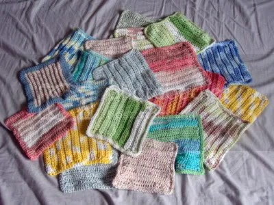 The latest washcloths! theyre all crocheted, which apparently Im not very good at yet, so theyre all wobbly and misshapen. And blocking all of them is way too overwhelming. So what if someones wash cloths all wobbly, itll block itself out when it gets wet. ...Right?
