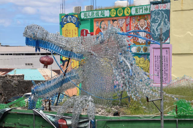 Dragon head made from plastic bottles that runs through out different buildings in China Town Port Louis, Mauritius