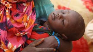 Kenya - A child sleeps at the Ifo refugee camp