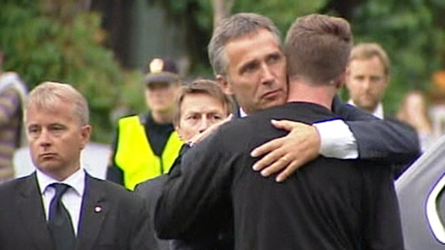 Jens Stoltenberg comforts Eskil Pedersen, the leader of the Norwegian Labour Youth league