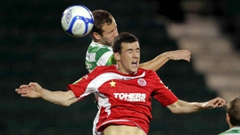 Shamrock Rovers' Pat Sullivan gets up ahead of Aaron Greene