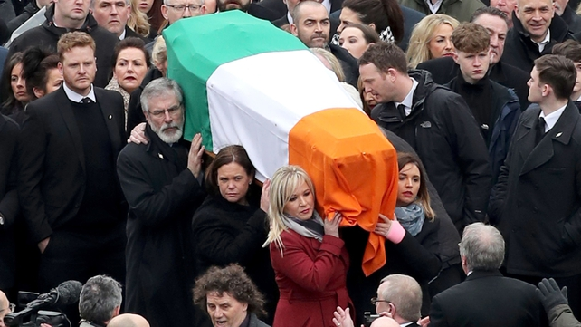 Sinn Féin's Michelle O'Neill, Mary Lou McDonald and Gerry Adams carry Martin McGuinness's coffin
