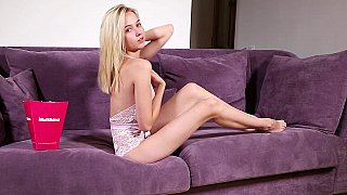 Solo on a couch with a slim natural tits blonde porn image