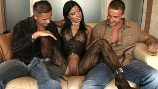 Fantastic brunette Kyra Black seduces two men on the couch porn image