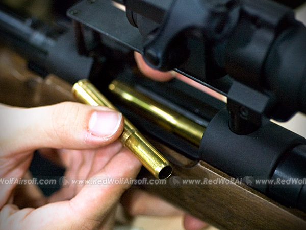 The scope mount blocks the stripper clip, but the large shells are easy to handle even when separated.