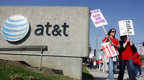 21,000 AT&T workers poised for strike over benefits, internet access