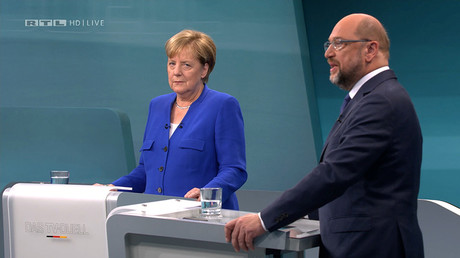 A screen that shows the TV debate between German Chancellor Angela Merkel of the Christian Democratic Union (CDU) and her challenger Germany's Social Democratic Party SPD candidate for chancellor Martin Schulz in Berlin, Germany, September 3, 2017 © MG RTL D