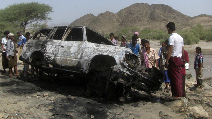 People gather at the site of a drone strike on the road between Yafe and Radfan districts of the southern Yemeni province of Lahj August 11, 2013. (Reuters)