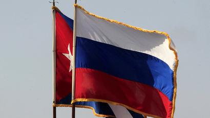 The Cuban and Russian national flags (Reuters/Enrique De La Osa)