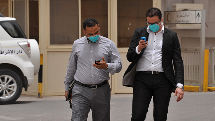 Egyptian medical workers wear masks as they leave the emergency section in King Fahad hospital in the city of Hofuf, 370 kms East of the Saudi capital Riyadh (AFP Photo)
