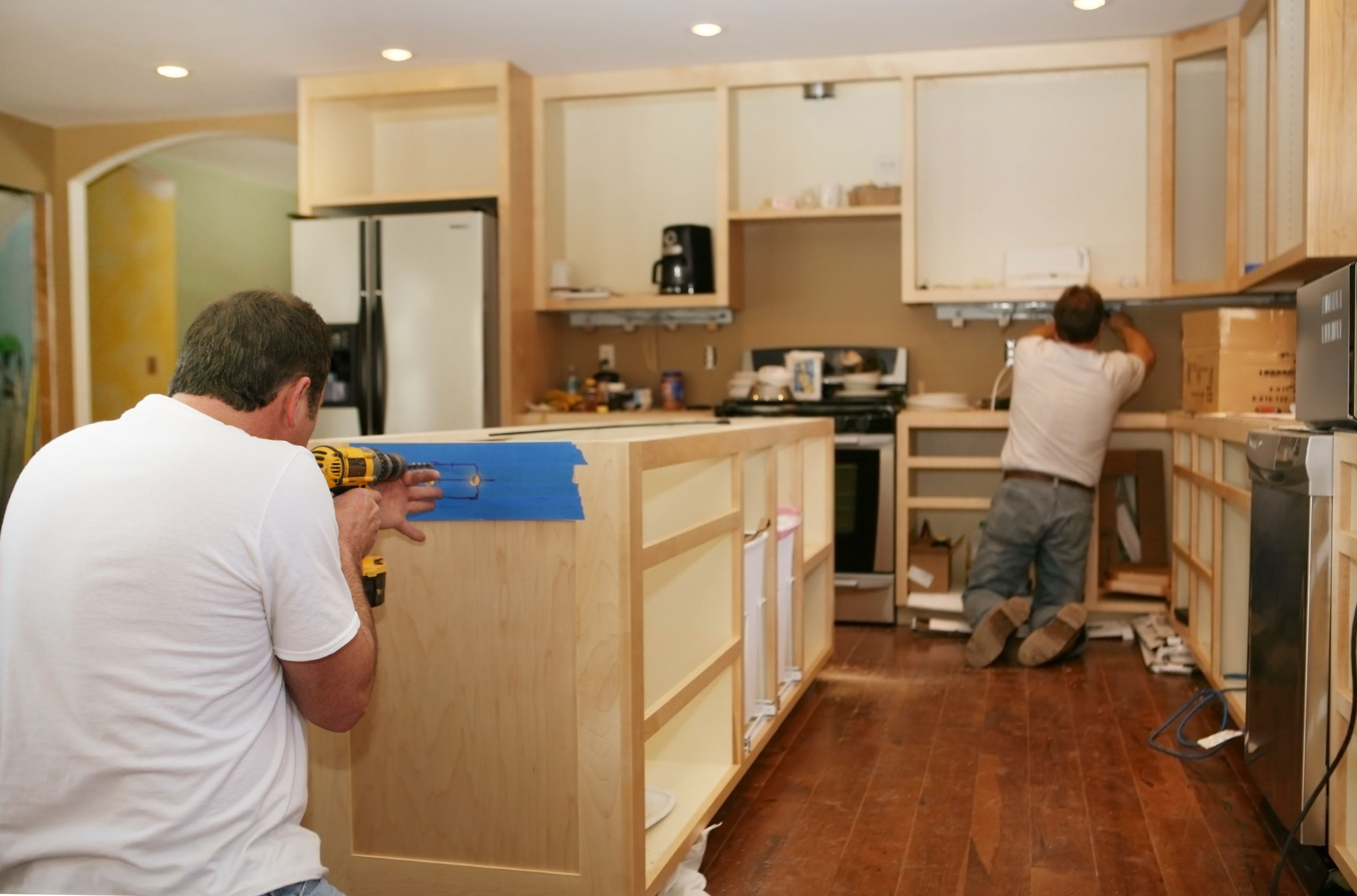 Contractors remodeling kitchen