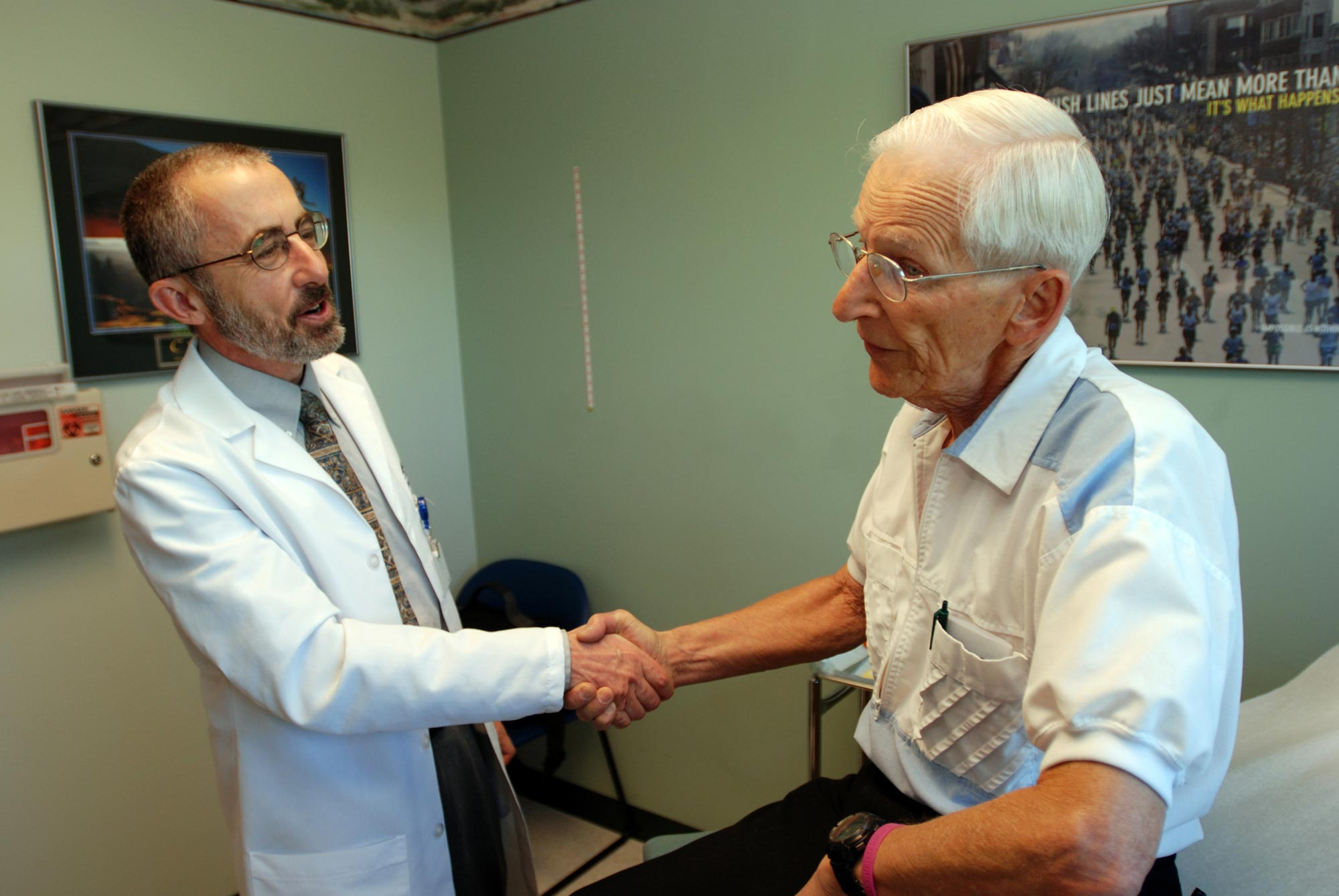 A Medicare patient shakes hands with his doctor after an appointment in Grants Pass, Oregon.