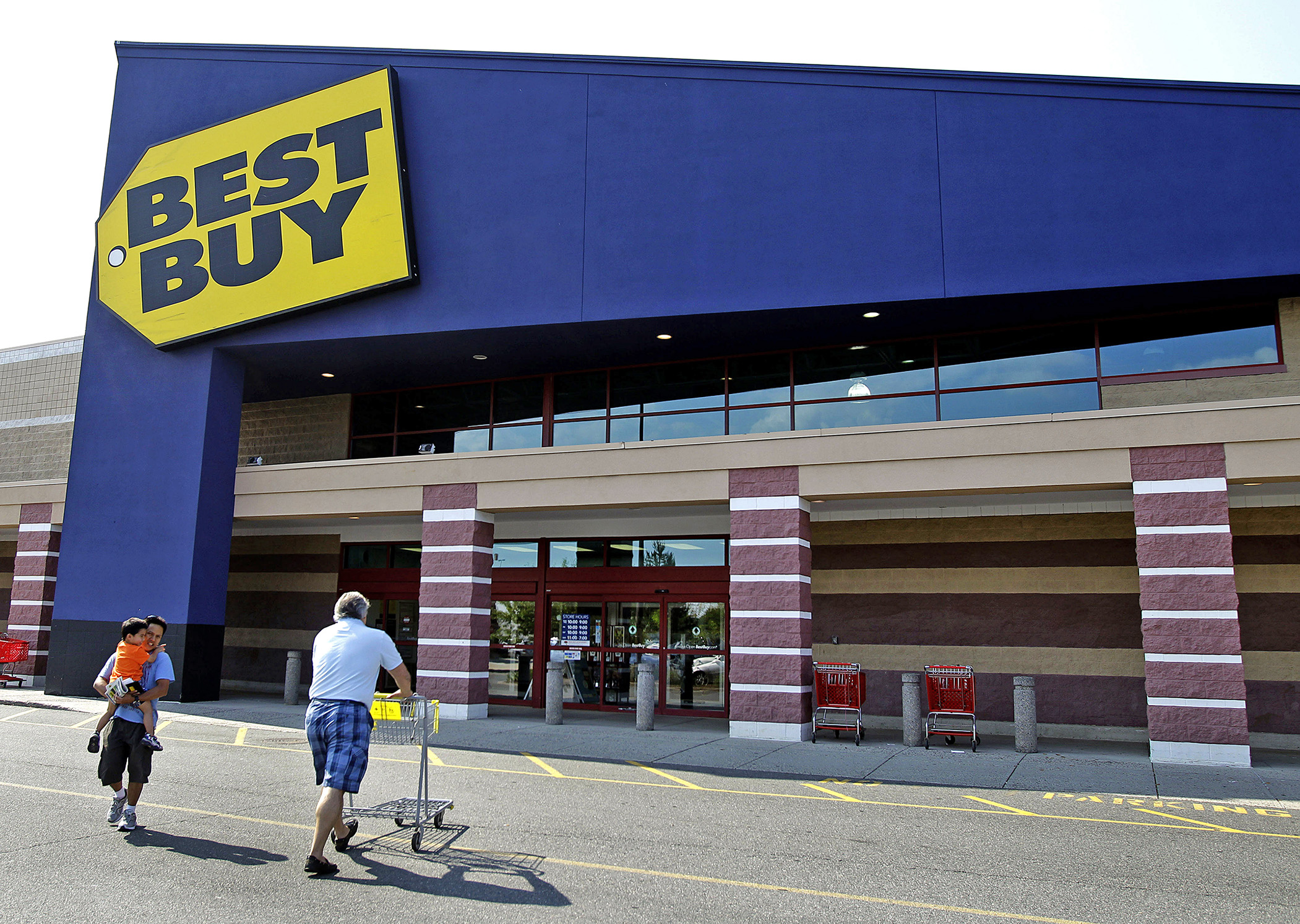 Customers walk in and out of Best Buy.