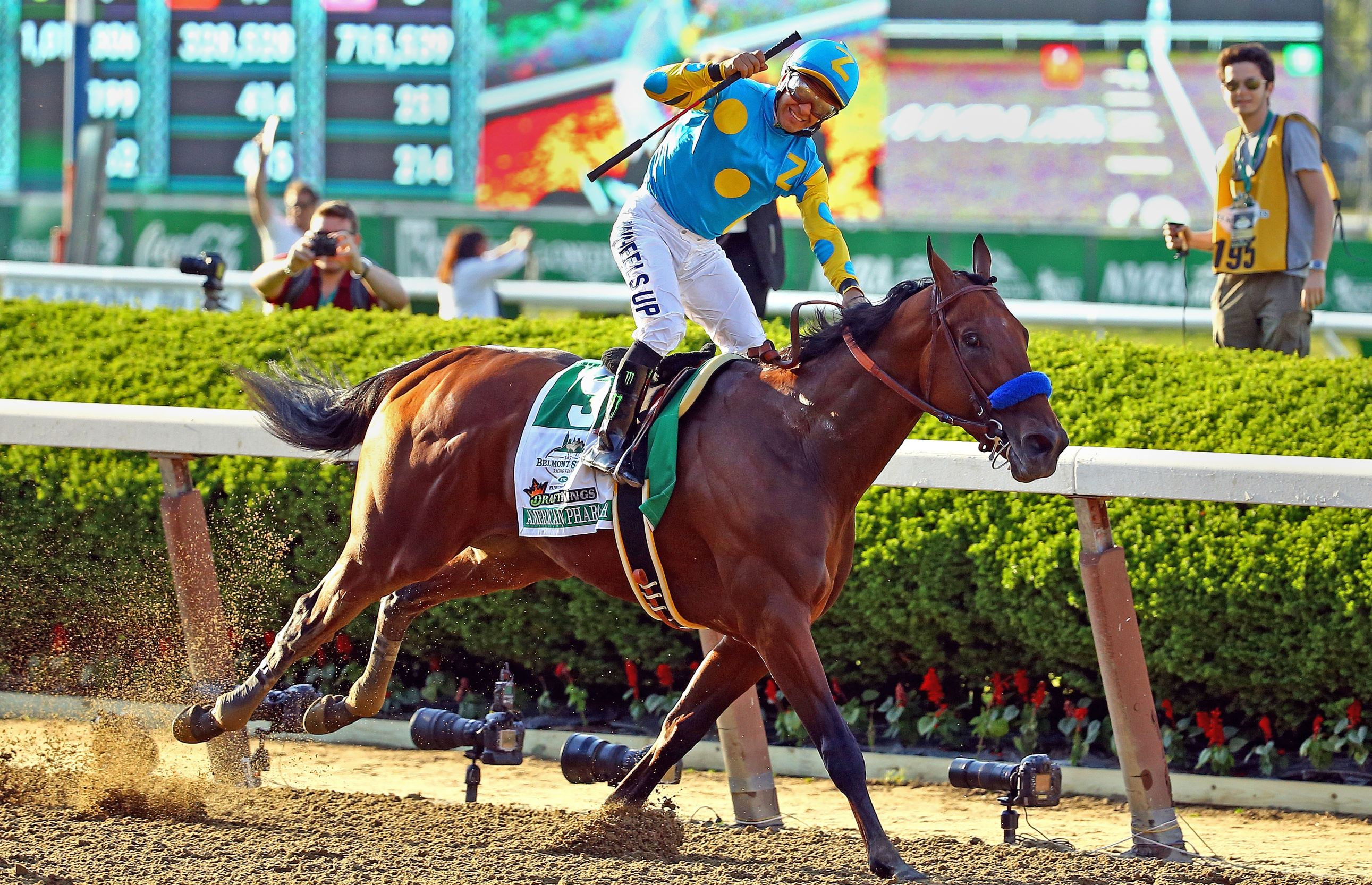 Victor Espinoza celebrates atop American Pharoah after winning the 147th running of the Belmont Stakes at Belmont Park on June 6, 2015 in Elmont, New York. With the win American Pharoah becomes the first horse to win the Triple Crown in 37 years.