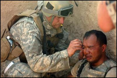 Giving aid to a soldier in Afghanistan