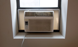 Air conditioner unit in window.