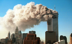 Smoke pours from the twin towers of the World Trade Center after they were hit by two hijacked airliners in a terrorist attack September 11, 2001 in New York City. Click image to expand.