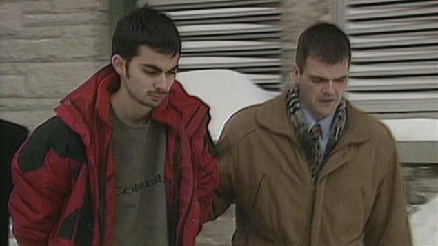 André Roy lors de son arrestation en février 2000.