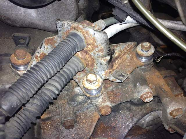 Reinstall original bolts by hand then tighten with ratchet.