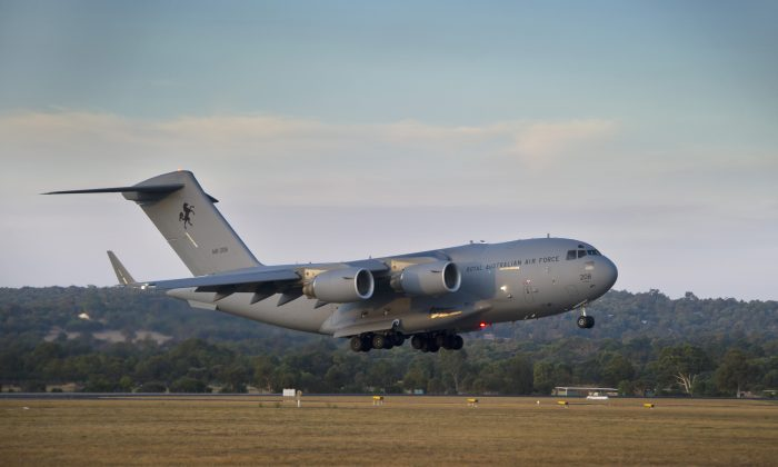 A Royal Australian Air Force C-17 Globemaster prepares to land at RAAF Pearce Base, Western Australia on March 28, 2014. (AP Photo/Australian Defence, Oliver Carter)